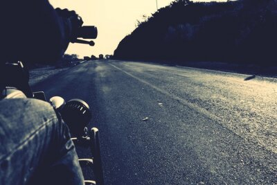 Poster Cropped Image Of Man Riding Motorcycle On Road