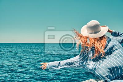 Poster Cruise ship vacation woman enjoying travel vacation at sea. Free carefree happy girl travel at ocean or sea. Woman on a yacht enjoying the beautiful vacation.