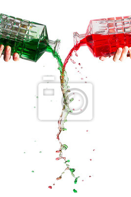 Crystal bottles pouring red and green liquid against a white background