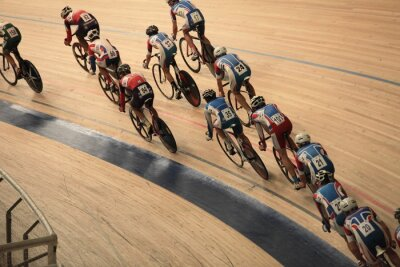 Poster cyclists to ride fast in a curve  top view