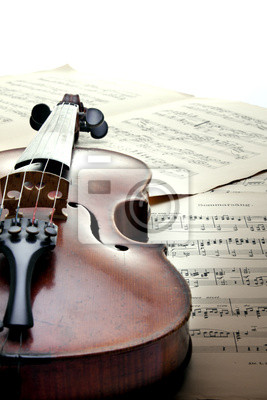 Detail of violin on sheet music. Overexposed. Vintage style.