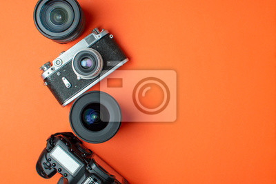 Poster digital SLR camera and film camera with a set of lenses on a colored background, the progress of photo equipment