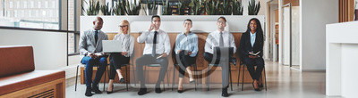 Poster Diverse group of businesspeople waiting together in an office re