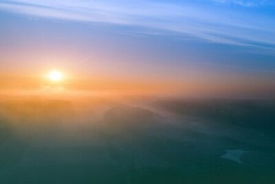 Poster Early misty morning. Sunrise in countryside. Rural landscape in early spring. Aerial view