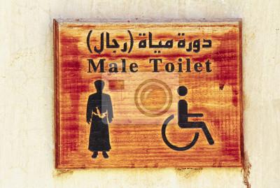 Eine altmodische WC-Zeichen an einer Wand hängen.