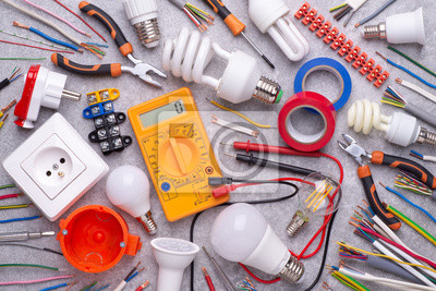 Poster Electrician equipment on wooden background, top view