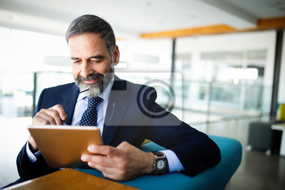 Poster Elegant business multitasking multimedia man using devices