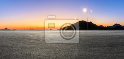 Poster Empty asphalt road and mountains at beautiful sunset