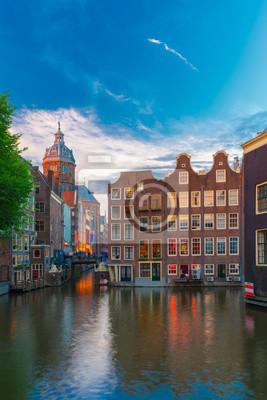 Evening Amsterdam canal, church and bridge