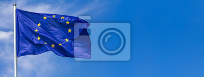 Poster Flag of the European Union waving in the wind on flagpole against the sky with clouds on sunny day, banner, close-up