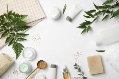 Poster Flat lay composition with different body care products and space for text on white background