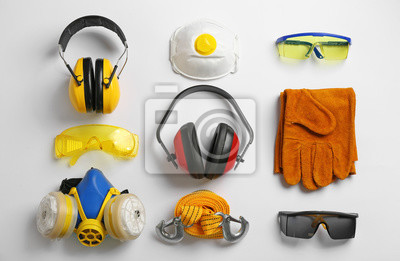 Poster Flat lay composition with safety equipment on white background