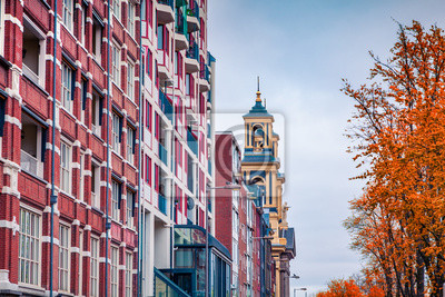 Fragment of typical Dutch architecture in Amsterdam city. Colorful autumn morning in Netherlands, Europe. Traveling concept background.