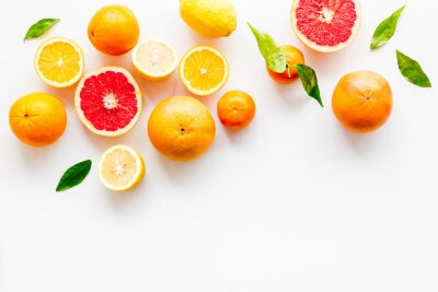 Poster Fresh citrus frame. Oranges, tangerines, grapefruits, leaves on white background top-down copy space