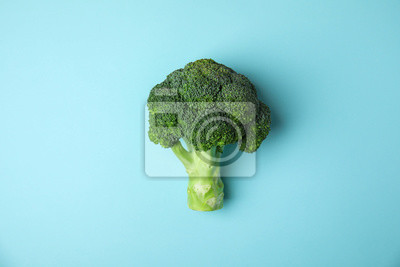 Poster Fresh green broccoli on color background, top view. Organic food
