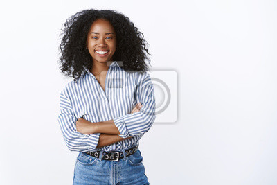 Poster Friendly cheerful attractive african american curly-haired young 25s woman consultant woking talking coworkers smiling pleasant having fun enjoying relaxing company mood, standing hands crossed chest