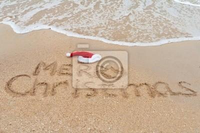 Frohe Weihnachten am tropischen Strand Sand geschrieben