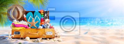 Poster Full Suitcase With Accessories On Tropical Beach