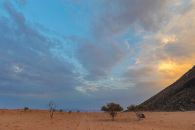 Golden colored clouds at sunset in the Namib Desert