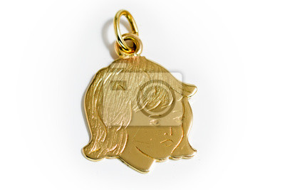 Golden pendant in the shape of a childs head on a white background