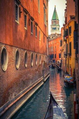 Gondolas on narrow canal in Venice