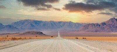 Poster Gravel road and beautiful landscape in Namibia