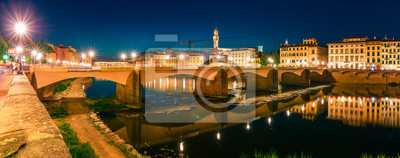 Great evening scene with Ponte alle Grazie bridge over Arno river. Enchanted night view of Florence, Italy, Europe. Traveling concept background.