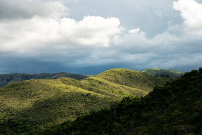 Green hills with trees and cloud sky in Minas Gerais state in Brazil