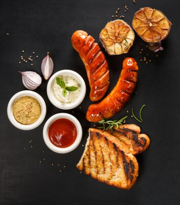 Poster Grilled sausages with different types of dips