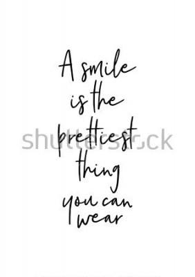 Poster Handgezeichnete Schriftzug. Tinte Abbildung. Moderne Bürstenkalligraphie. Isoliert auf weißem hintergrund. Ein Lächeln ist das Schönste, was Sie tragen können.