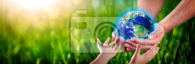 Poster Hands Of Man Giving Earth To Child - Protect The Environment For Future Generations Concept - Some Elements Of This Image Provided By NASA