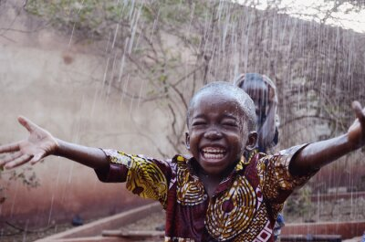 Poster Happy African Children Finally Getting Water during the Dry Season in Bamako, Mali