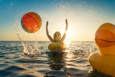 Poster Happy child having fun on summer vacation