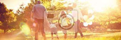 Poster Happy family walking at park