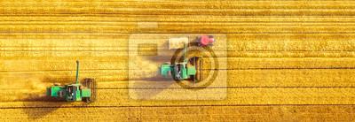 Poster Harvester machine working in field