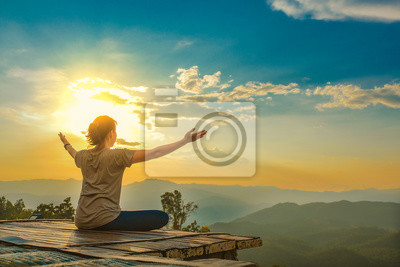 Poster Healthy woman lifestyle balanced practicing meditate and zen energy yoga outdoors on the bridge in morning the mountain nature. Healthy life Concept.