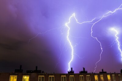 Heavy lightning flashes over Amsterdam, the Netherlands, during a storm in summer at night
