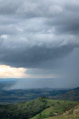 Heavy rain in an open green field in Brazil