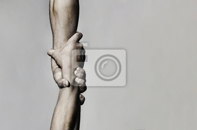 Poster Helping hand concept and international day of peace, support. Helping hand outstretched, isolated arm, salvation. Close up help hand. Two hands, helping arm of a friend, teamwork. Black and white