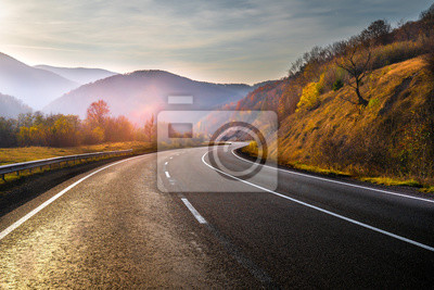 Poster Highway in mountains in autumn evening