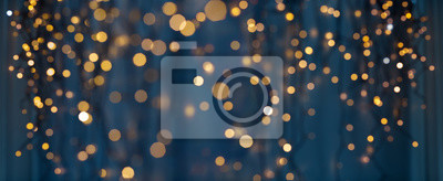 Poster holiday illumination and decoration concept - christmas garland bokeh lights over dark blue background