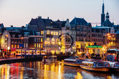 Illuminated buildings in the center of Amsterdam, Netherlands at night