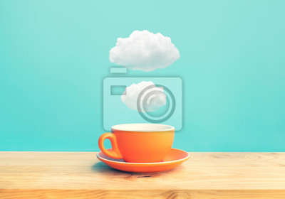 Poster Inspiration creativity concepts with a cup of coffee on wood bar table with some cloud on blue sky color background