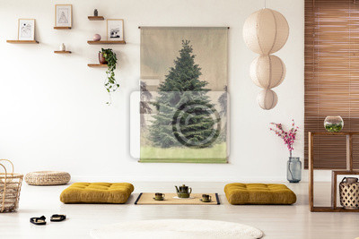 Japanese dining room interior with a tree poster lamp pillows