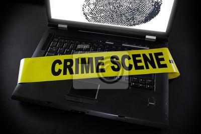 Laptop mit Fingerabdruck Tatortband über sie