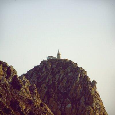 Poster Leuchtturm auf der Spitze der Stein Klippe