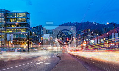Poster light trails go out of the downtown vancouver