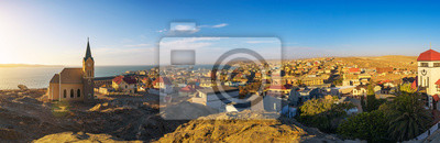 Poster Luderitz in Namibia with lutheran church called Felsenkirche at sunset