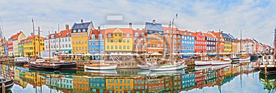 magical fascinating landscape with boats in a famous Nyhavn in the capital of Denmark Copenhagen. Exotic amazing places. Popular tourist atraction.