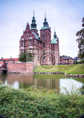 magical fascinating landscape with famous Rosenborg Castle near pond in palace garden in Copenhagen, Denmark. Exotic amazing places. Popular tourist atraction.